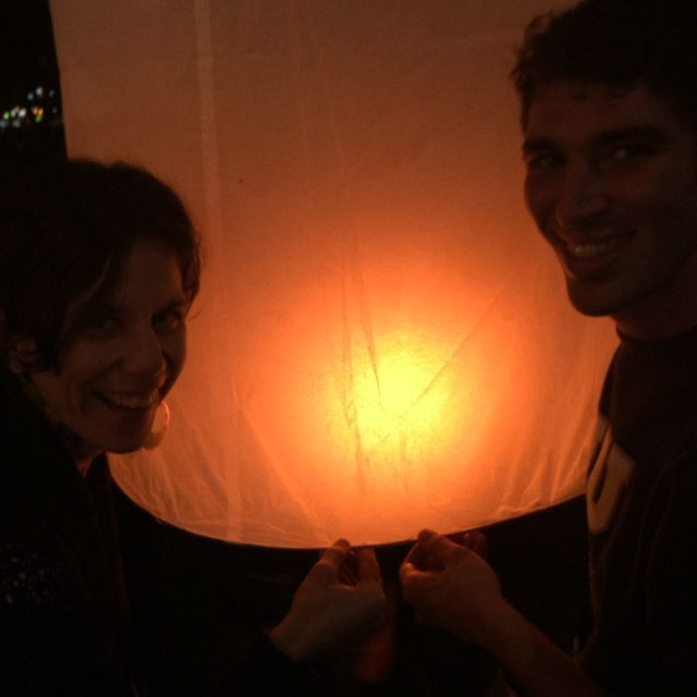 Eli helping me hold my lantern as it fills with hot air.