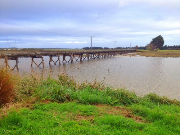 An old wooden rail bridge, now closed