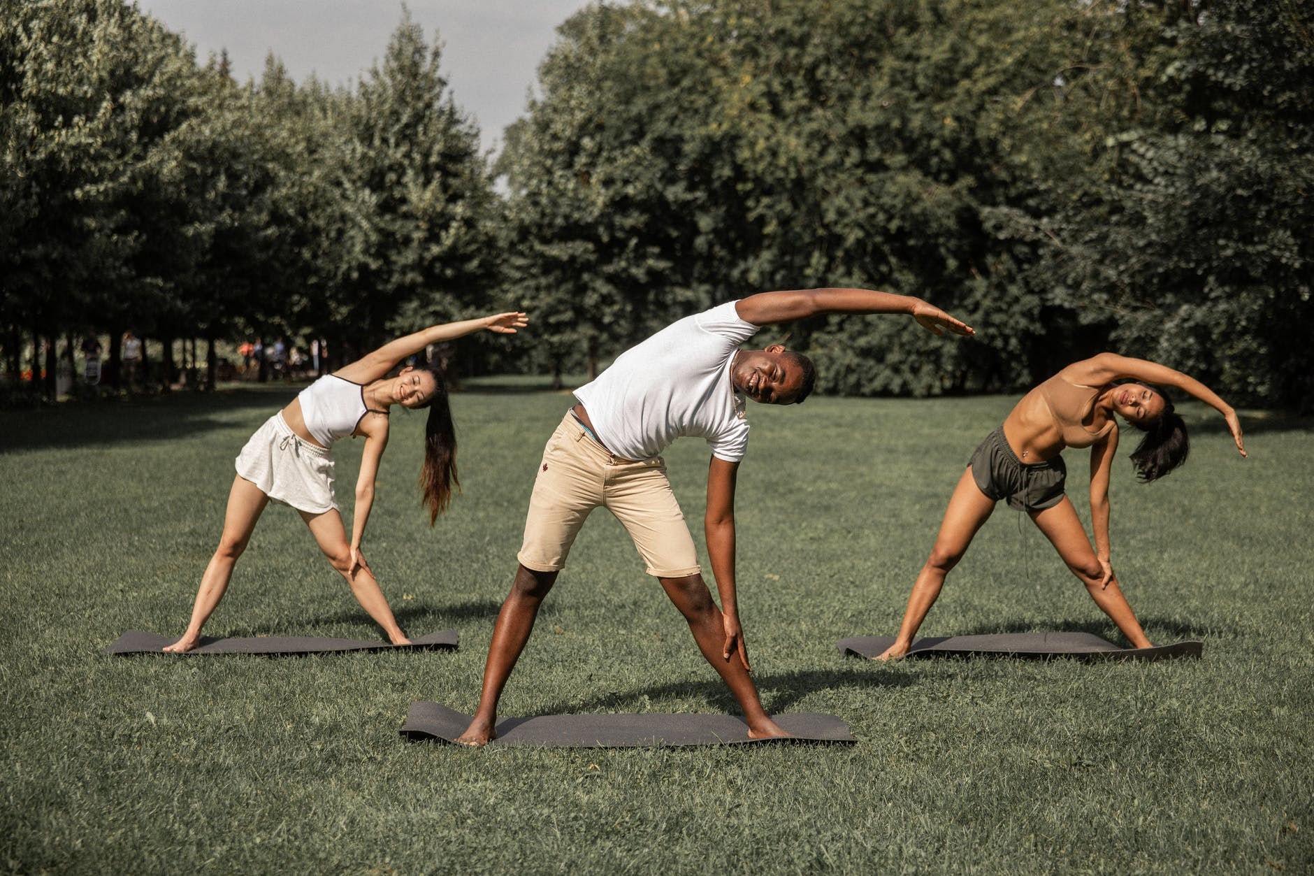 multiracial people doing reverse triangle pose