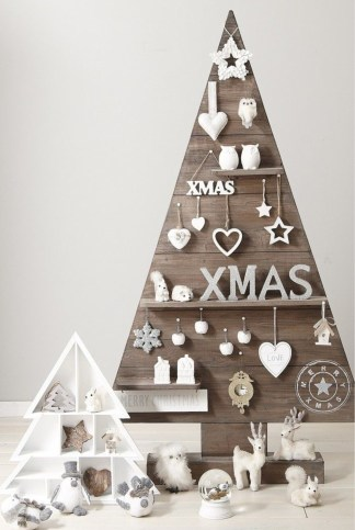 Wooden tree with collection of quirky pieces
