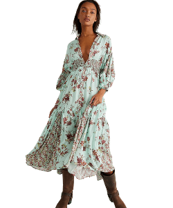 Forever femme and floral, this timeless shirtdress is featured in a button-front, maxi silhouette with smocked waistline and exaggerated sleeves for added shape.