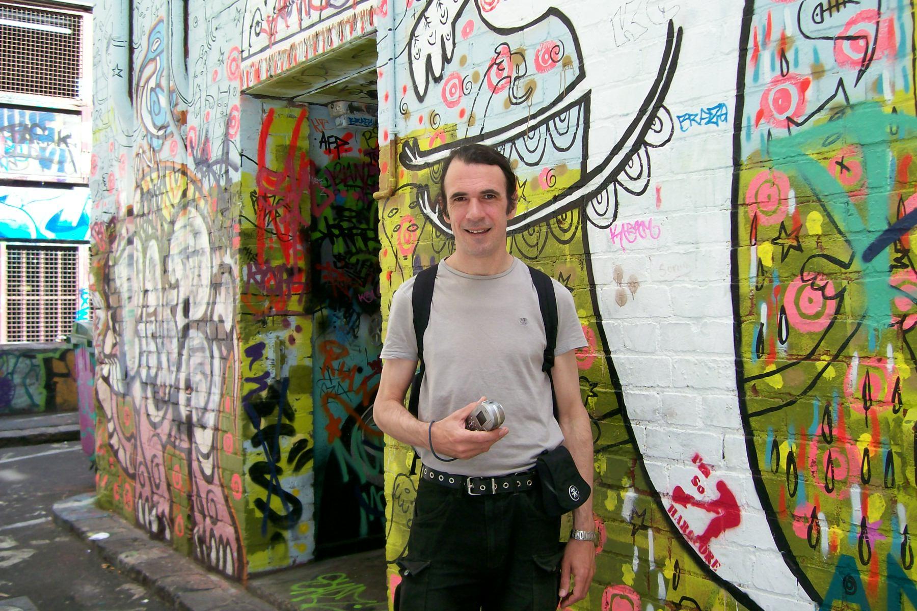 Mark Holsworth with Melbourne graffiti