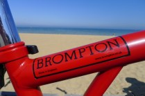 Brompton sticker on red frame with beach background - @daynaa2000