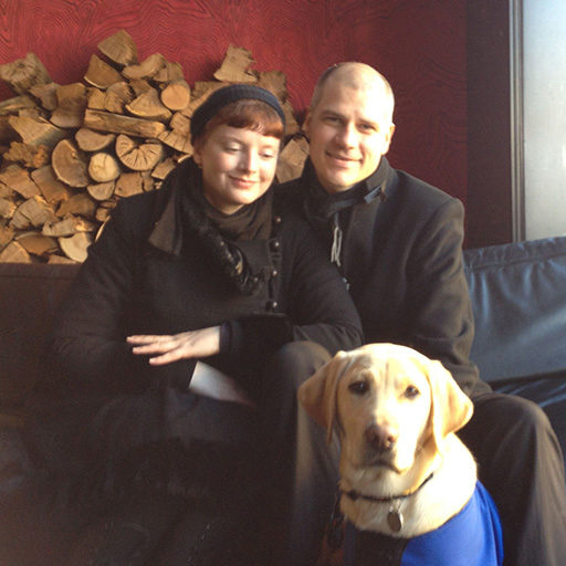 Melbourne house-sitters Dianna and Mark with Quinnell, the Guide Dog Puppy they raised in 2012.