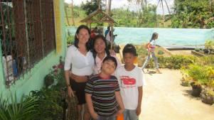 At the Tanza School with Principal Frecie Herrada de Angel.
