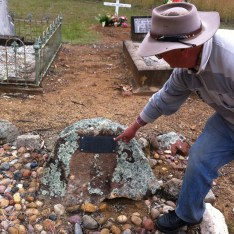 Showing me the graves of our ancestors.