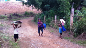 A grandmother and her two boys had already walked up a very steep hill to evacuate.