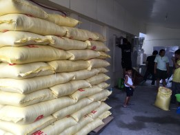 25kg bags of rice weighed into 8kg packs.