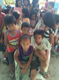 The little boy in purple shirt was so cute.
