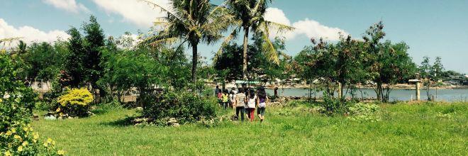 kids walk home along the shoreline banner