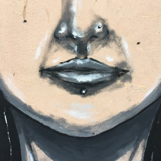 mural of a woman's lips, nose and chin