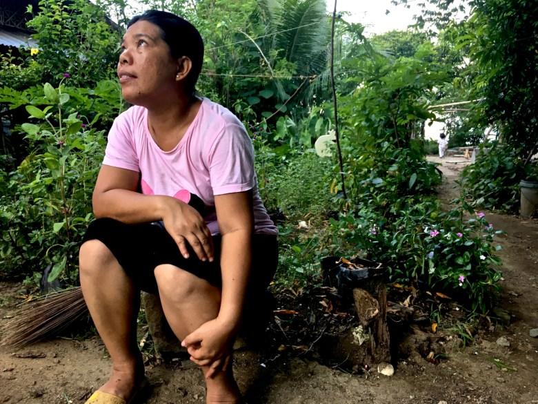 Filipina sitting in the garden