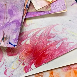 box of paper with marbled designs