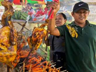 local Filipino vendor cooking native chicken