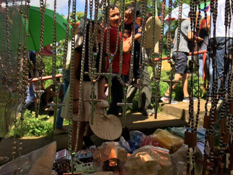 street vendor sells crosses and other religious stuff