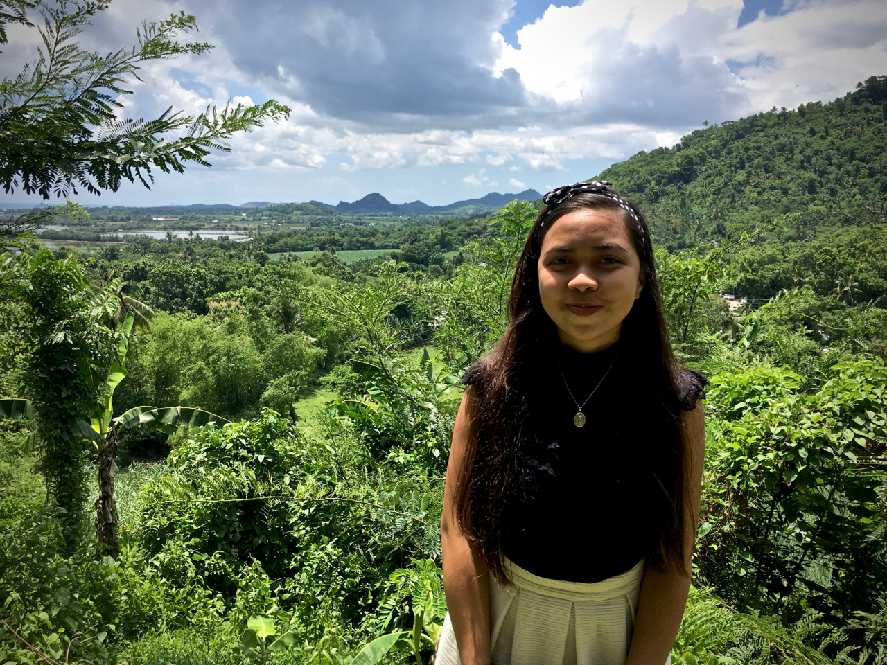 Eunice in front of the farmlands of Capiz, Philippines