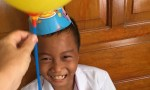 little kid in a party hat
