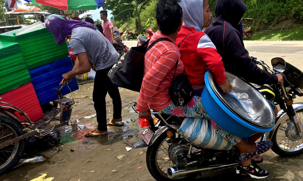 overloaded motorbike in rural Philippines
