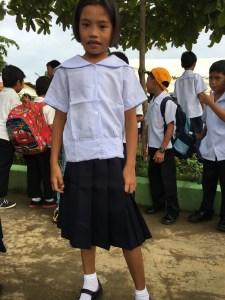 little girl in her school uniform