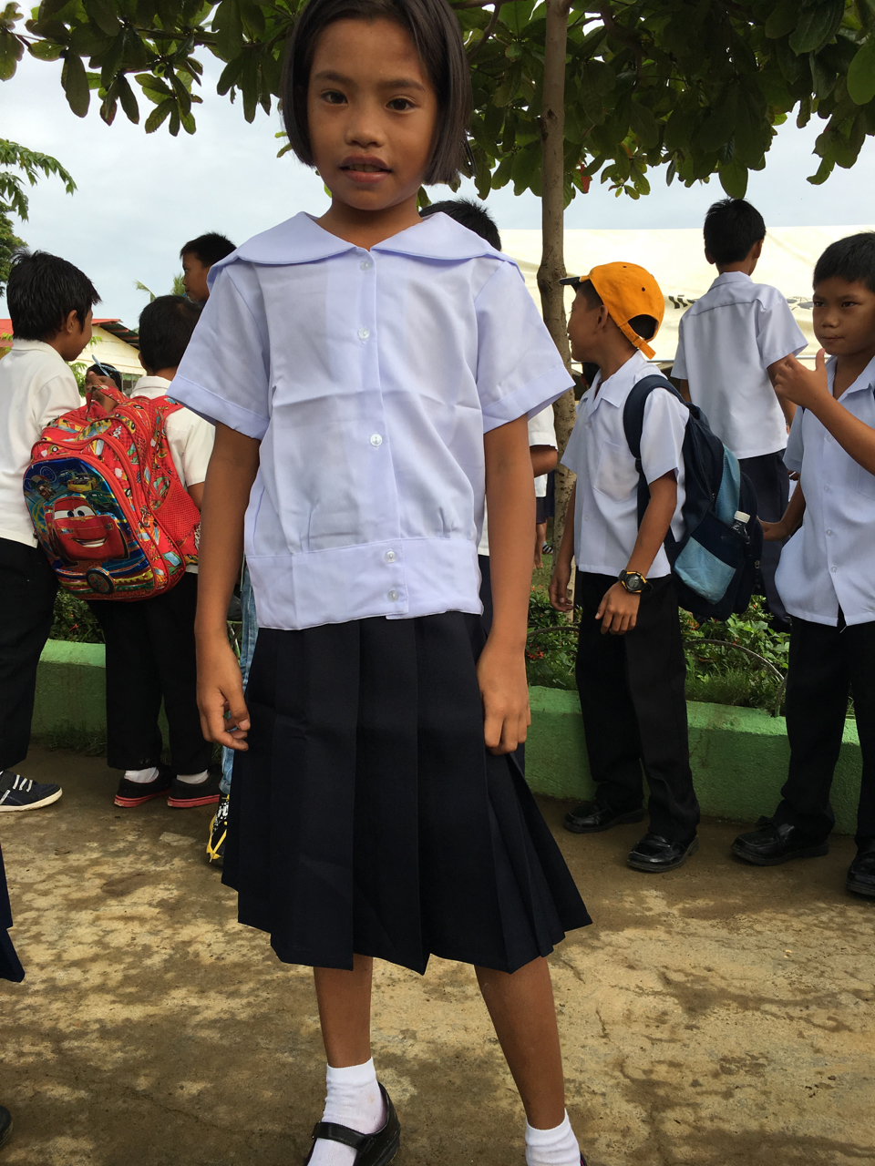 little girl in her school uniform