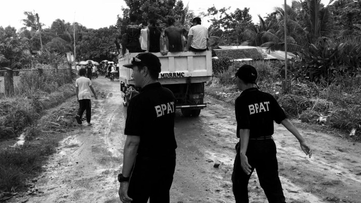 Barangay Officials walk with the mourners