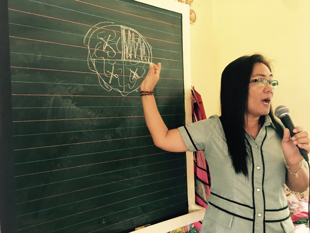 School Principal Ma'am Frecie explains the amount of coral being damaged