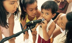 little boy using a microphone