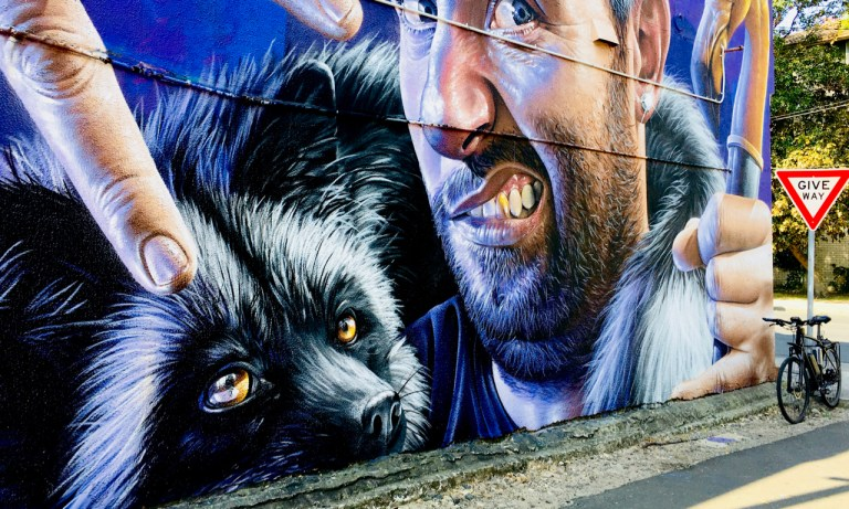 painted mural of a man and his pet