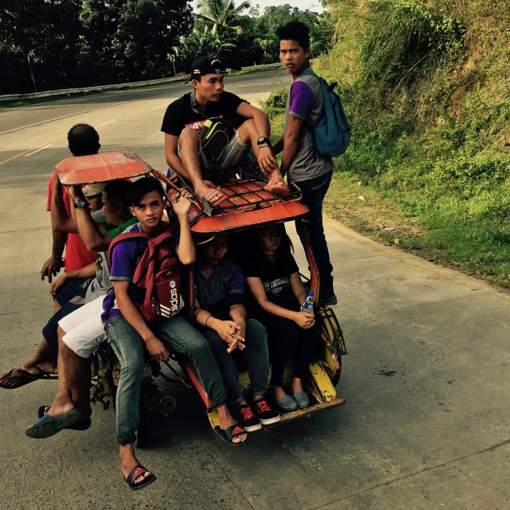 11 people riding a tricycle