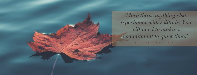 leaf on water with a quote