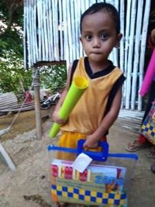 little Filipino boy with school supplies