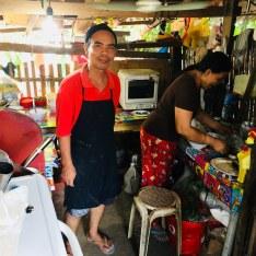 Filipino man in bamboo kitchen