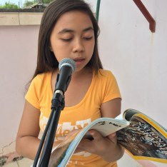 girl reading national geographic