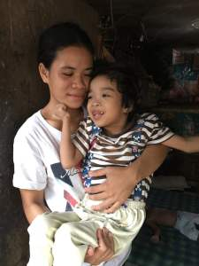special needs child with her mother
