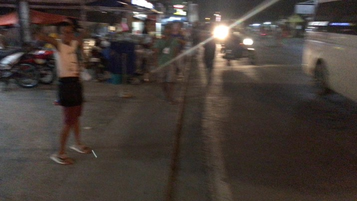 blurred shot of a boy on the road at night