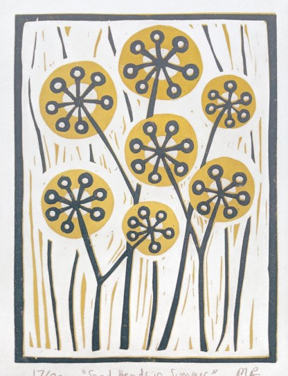Floral lino print by artist Melissa Birch showing dried flower heads in golden yellow with navy blue stems