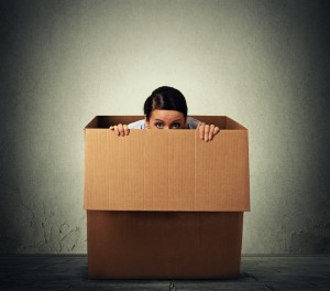 Women hiding in a box - phobia cure