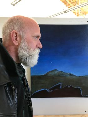"Mike Chambers and his painting ""Black Elk and the Morning Star"""