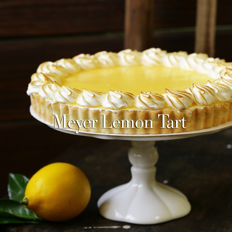 homemade baked lemon tart cake with meringue cream