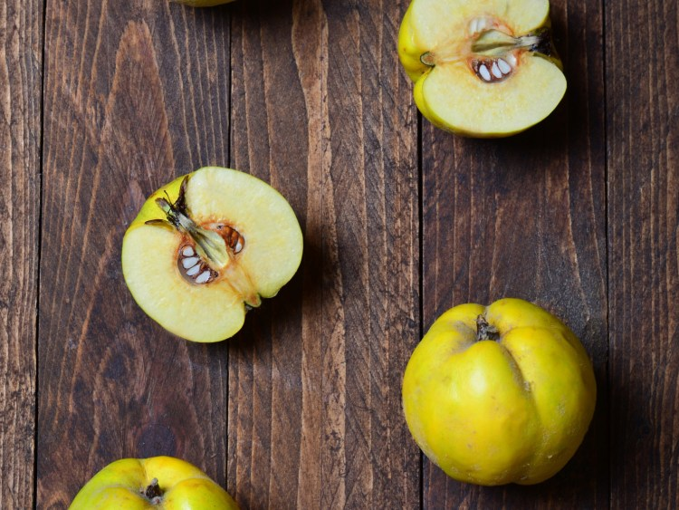 Quince on wooden background