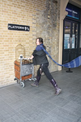 Some tourist posing at Platform 9 3/4. Photo by Andrea Gonzalez.