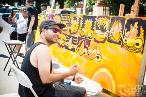 Artist Navid Dehghan painting at the Crocker Block by Block Party in District 5, July 9, Sacramento CA. Photo Melissa Uroff