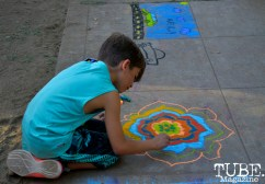 A child drawing with chalk at Chalk It Up in Sacramento, CA, September 4, 2016. Photo Emma Montalbano.