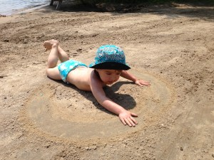 "From last year, but I love her ""swimming"" on the sand."