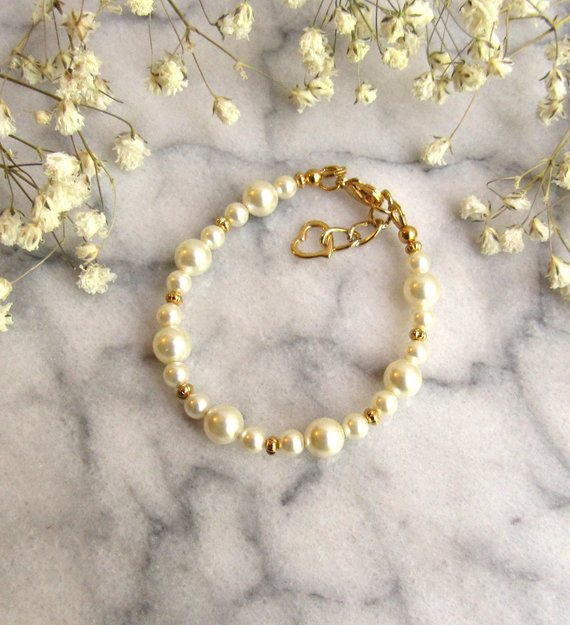 GB4 pearl baby bracelet with gold accents