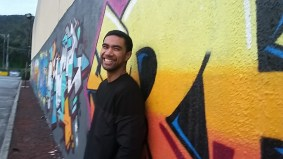 An amazingly handsome subject in front of a beautifully made graffiti wall in Dandenong.