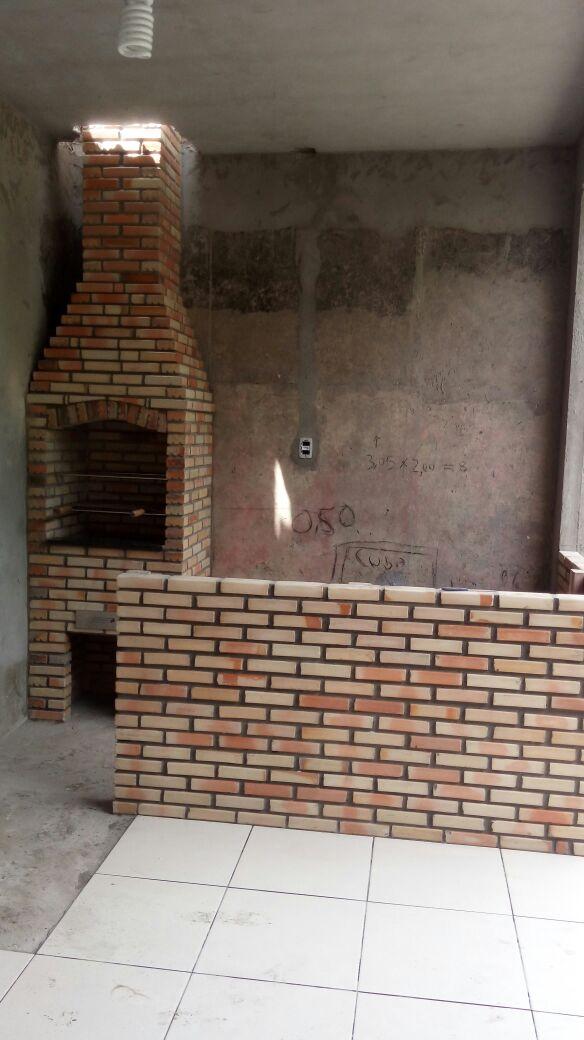 Churrasqueira com balco de tijolo macio
