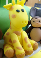 Fondant giraffe and monkey