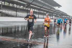 Participants enjoy their lap around the Indianapolis Motor Speedway despite the rain during the Annual OneAmerica 500 Festival Mini-Marathon on Saturday, May 4, 2019.
