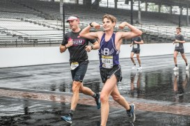Participants enjoy their lap around the Indianapolis Motor Speedway despite the rain during the Annual OneAmerica 500 Festival Mini-Marathon on Saturday, May 4, 2019.